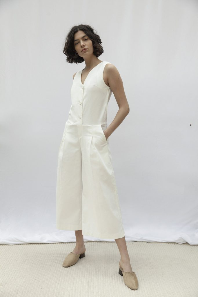women wearing organic cotton jumpsuit made by ethical fashion brand